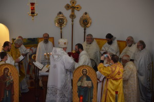 Valdyka Antony communes the newly ordained Deacon Michael at the newly consecrated altar.