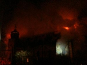 Smoke and fire obscure the view of the church as it burns in the pre-dawn hours of Michaelmass, 2012.