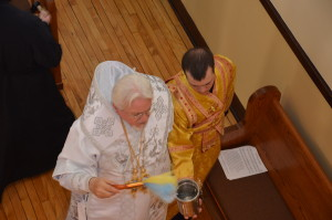 Sdn Ivan assists Mp Antony as he blesses the church.