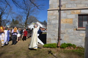 Fr. Myron Oryhon, former pastor of St. Michael's, leads the procession, blessing the walls.