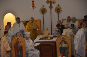 Deacons Paul and Vasyl lead Sdn. Michael around the altar.