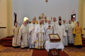 Valdyka and his concelebrating priests, deacons, subdeacons, and server.