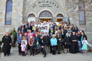 After the service, in front of the newly consecrated church.